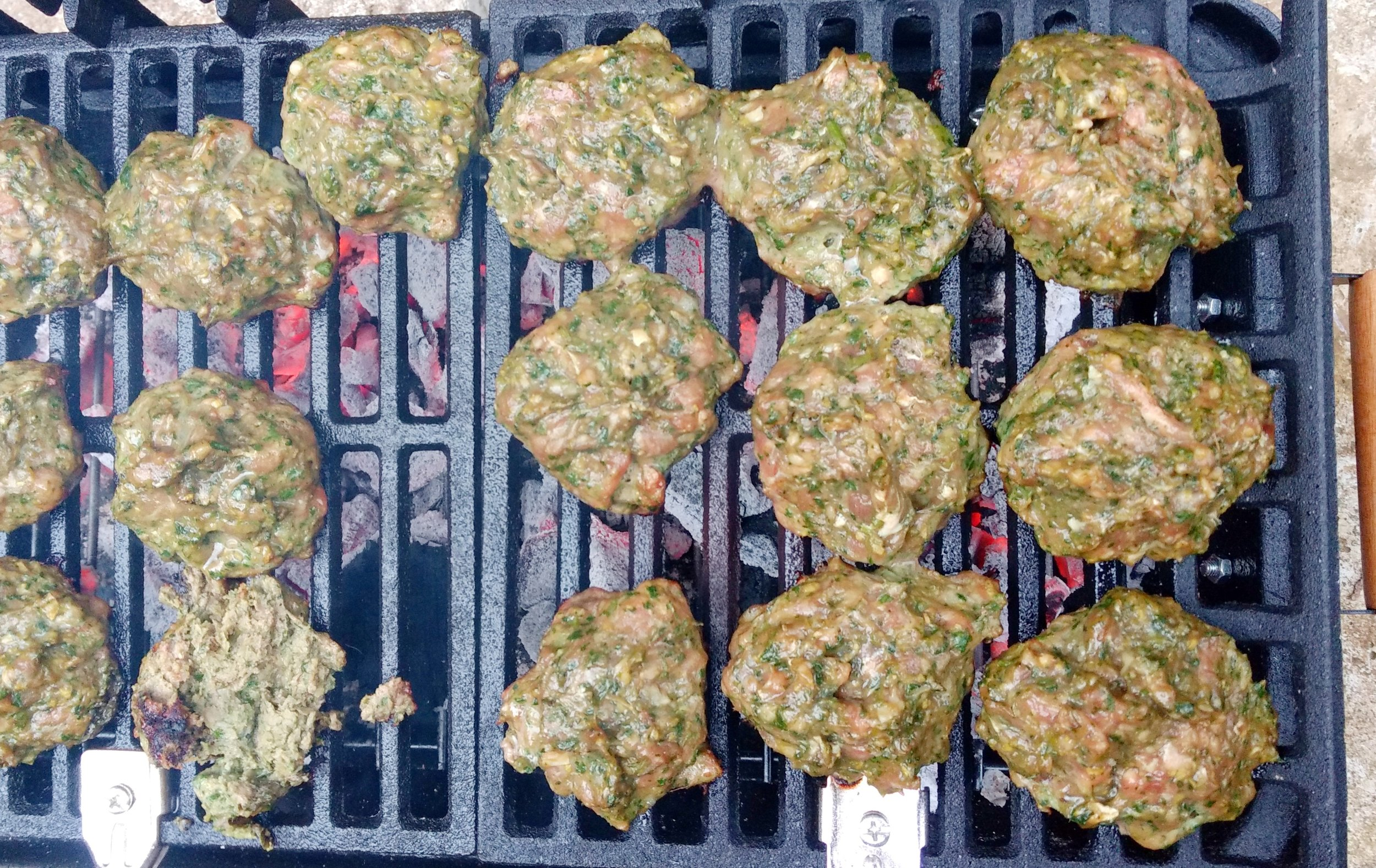 6- Or prepare a medium-hot fire in a charcoal grill or preheat a gas grill (we use the habachi pictured above). Grill the patties for about 4 minutes per side, or until done as you like. Serve with cauliflower rice and veggies sides. I made a fermented carrot salad and lemon radishes.