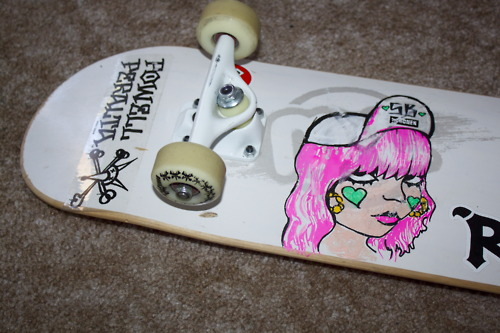 My personal skateboard that I doodled on- however the pink hair is not Posca it is Sharpie paint pens and it started to bleed. woops.