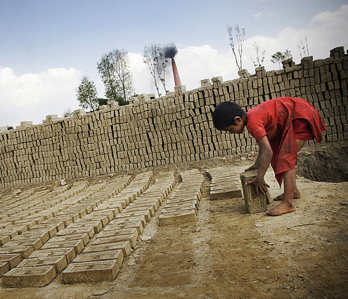 From a young age, children work long hours in dangerous conditions at brick factories to support family income