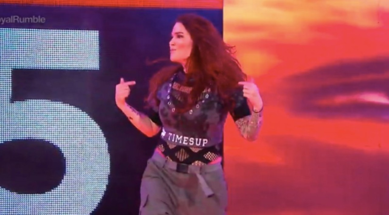 WWE Hall of Famer Lita wearing #TIMESUP on her way to the ring, days after Enzo Amore is released for accusations of sexual assault.