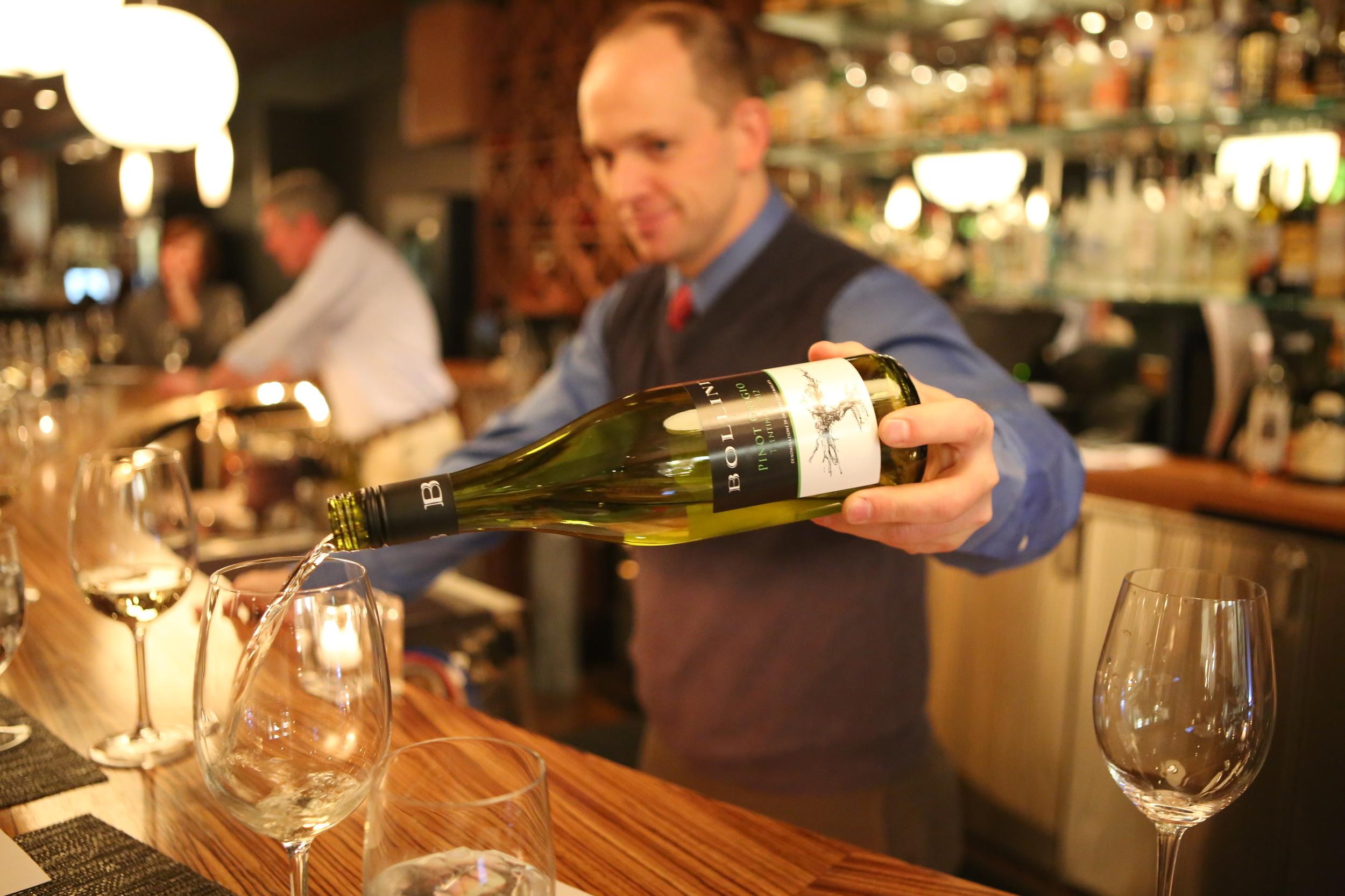 Daniel pouring the Bollini Pinot Grigio