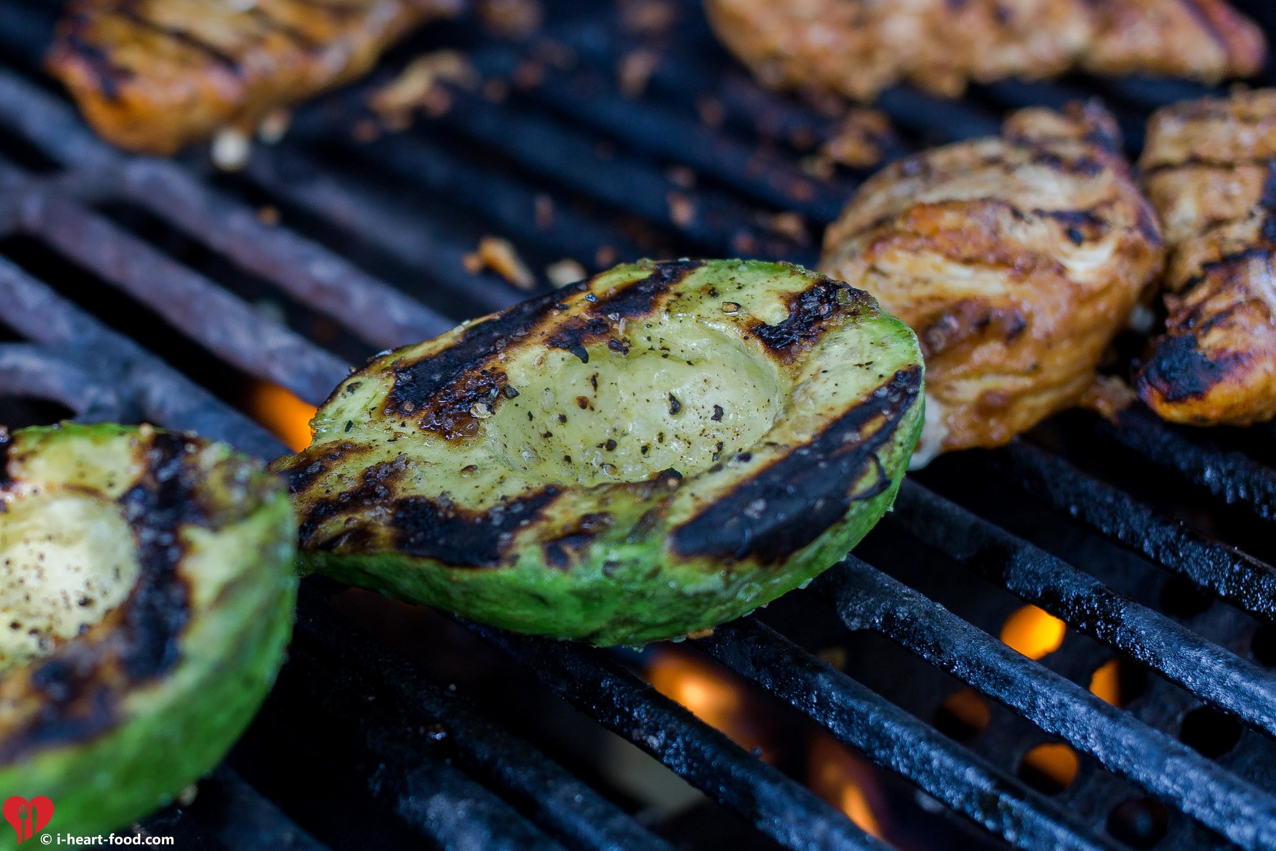 Avocado on the grill with some chicken breast.