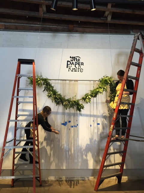 Hanging the steel ball chain curtain.
