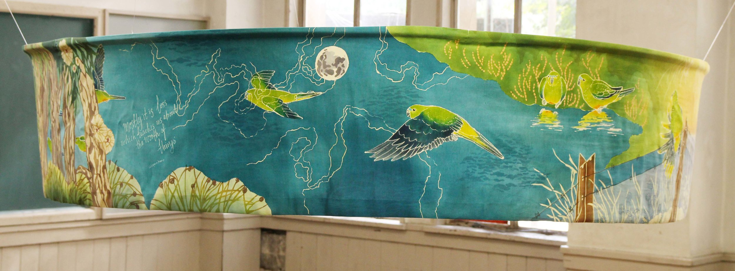 Loss & Worth, 2013. Katazome and Yuzen on silk.  4.5 metres long x 33cm high. A scroll scene depicting the migration of Critically Endangered Orange-bellied Parrots.Image forms a loop so the migration cycle continues.