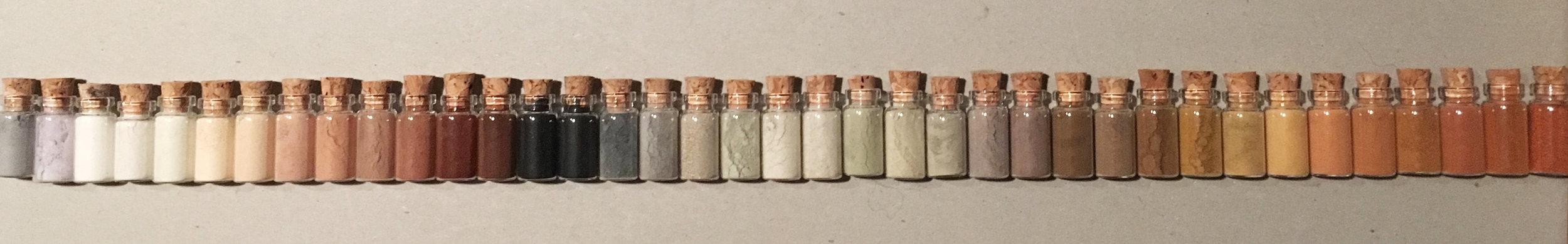 """Tiny Museum of Natural Pigments"" work in progress, 2018. Glass vials 2.5cm. Colours from rocks, soil, shells, ash."