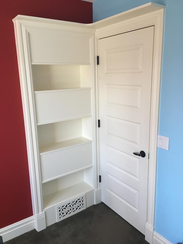 """Unique bookcase behind doors - Got holes in the wall from door handles? Make a bigger hole and have a double sided bookcase! This bookcase has 9"""" deep shelves and is staggered with three openings on each side. So one room has three storage shelves, and the opposite room has the same design but shelves are staggered to have plenty of depth for each room as needed."""