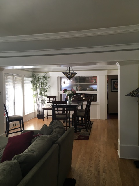 Large crown molding and plate rails surround the dining room.