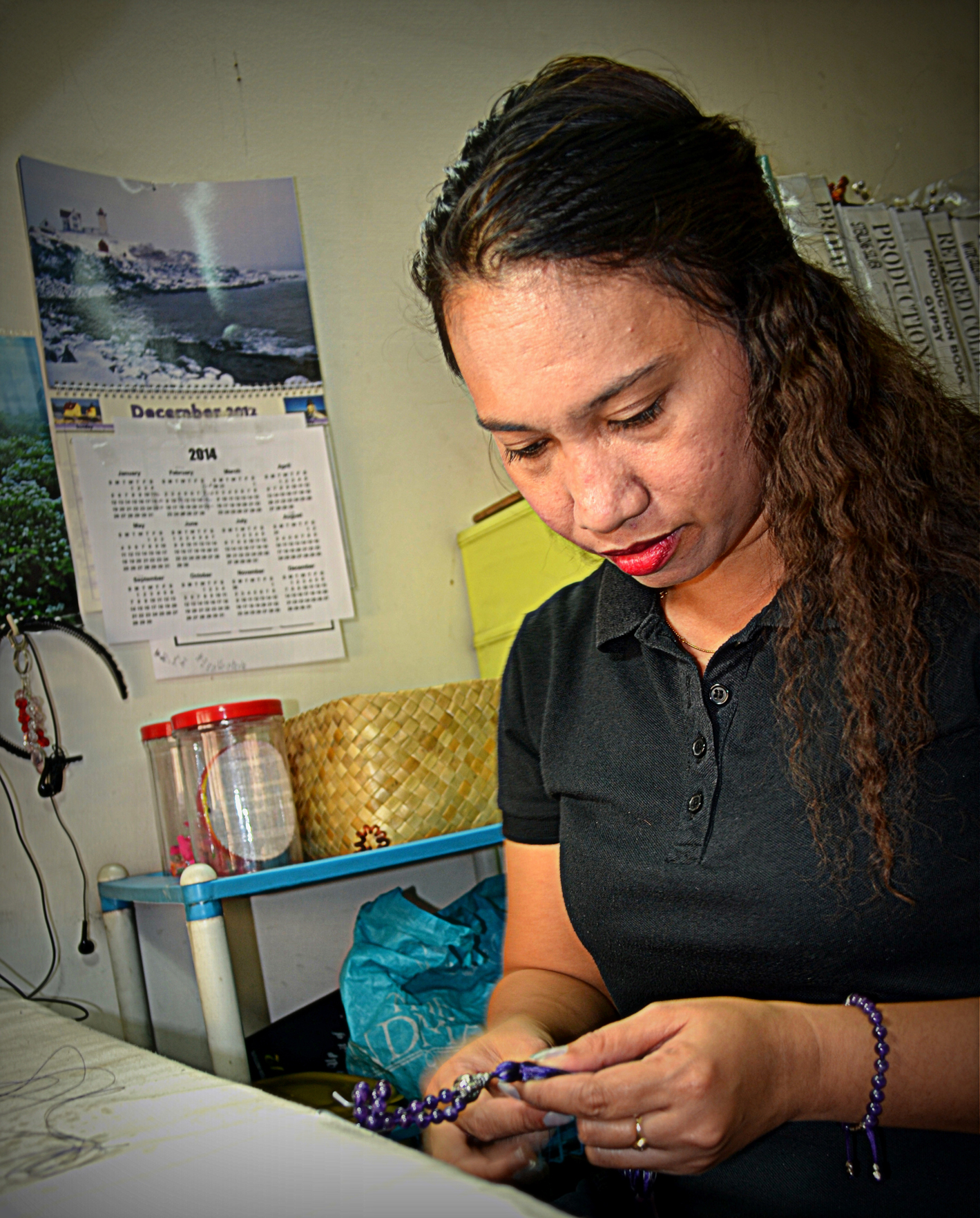 A Filipino artisan from our partnering co-op working to create mala bead necklaces for the Mala and Mantra line.