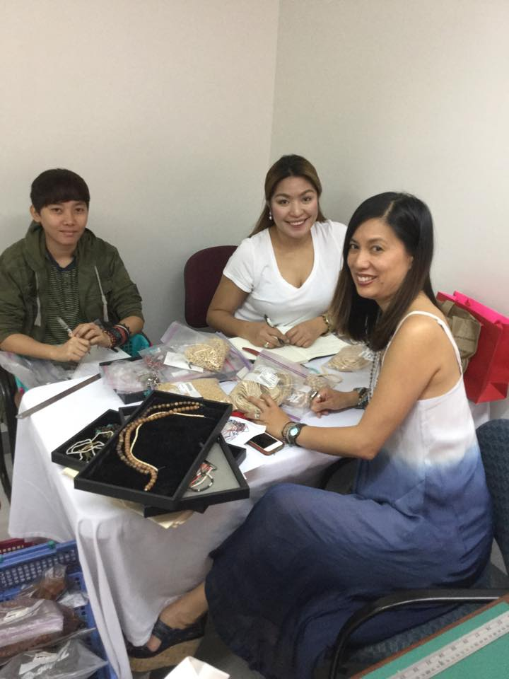 M+M founder JPC working alongside female jewelry design artisans from our Fair Trade cooperative in the Philippines to create the Summer 2015 Collection.