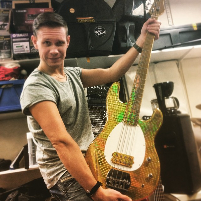 Danny is most pleased with the new bass. A slightly cheaper version of a Bootsy Collins signature. #bling #allaboutthebass #goldfunk #TapeItTilYouMakeIt