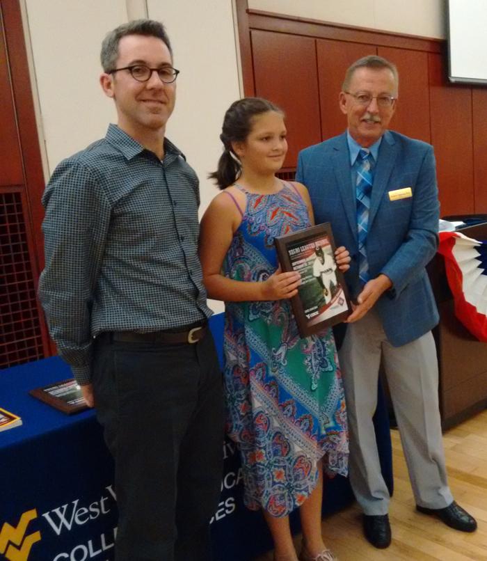 Awarding art prize to WV 6th Grader.