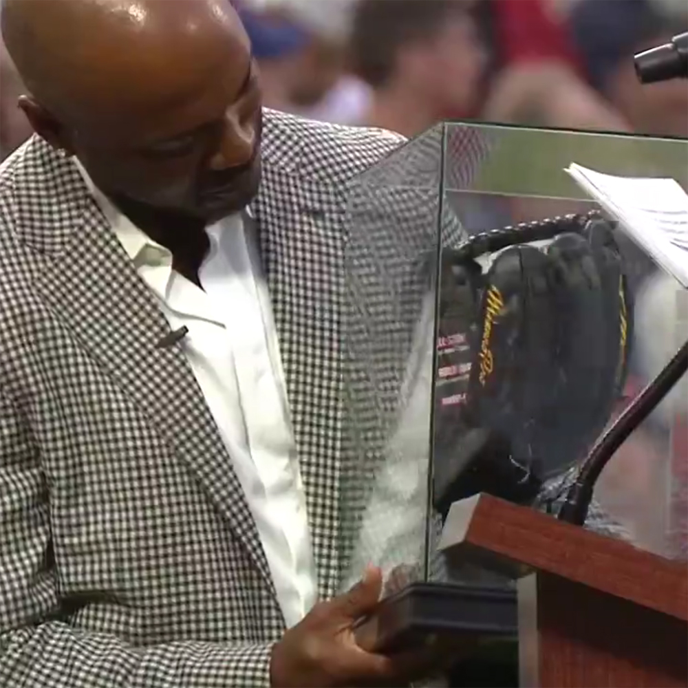 Jimmy Rollins looking at Baseball Glove Art by Sean Kane, presented to him by the Phillies.