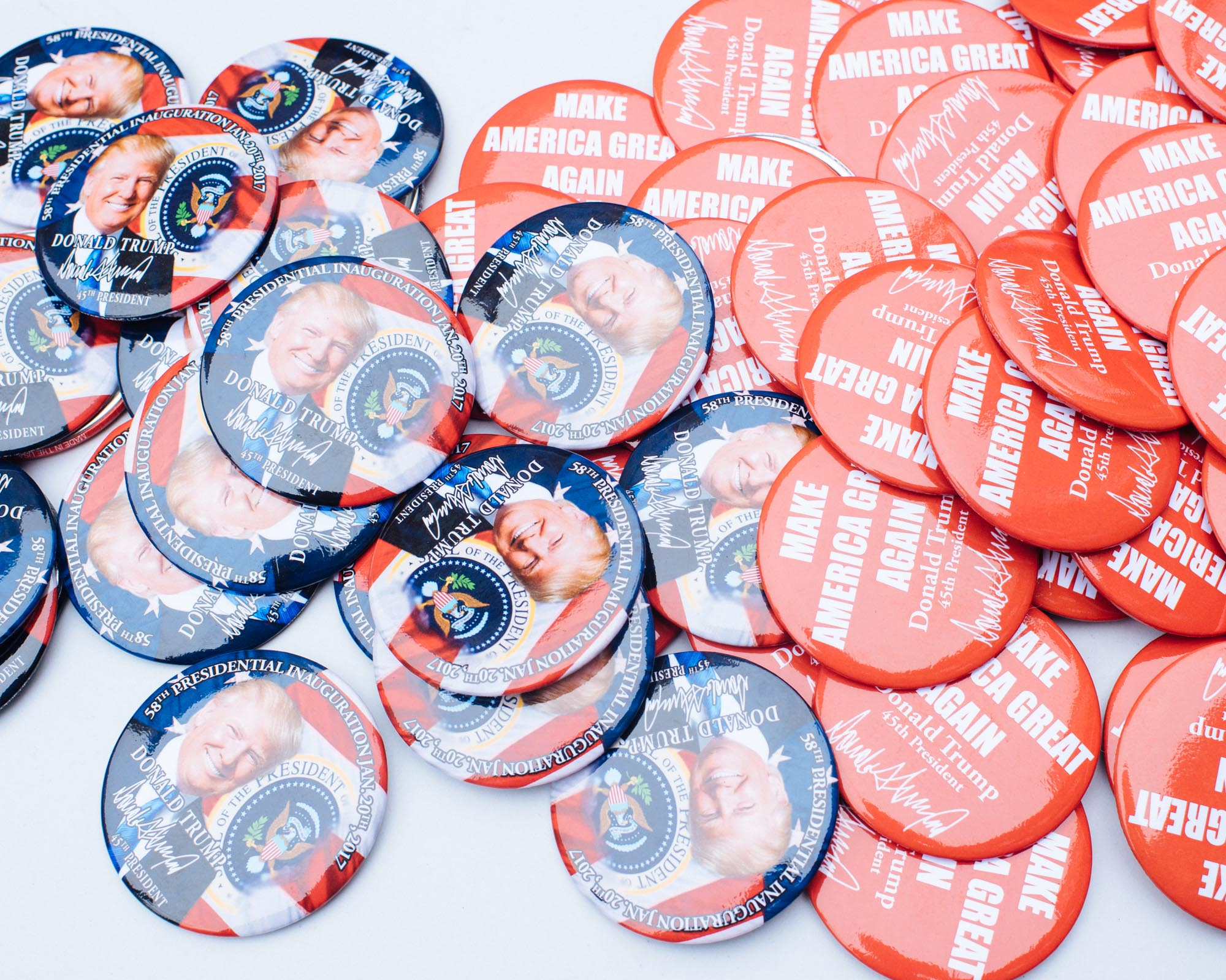 At the day after the inaugartion, street vendors sell buttons and shirts of President Trump at reduced prices.