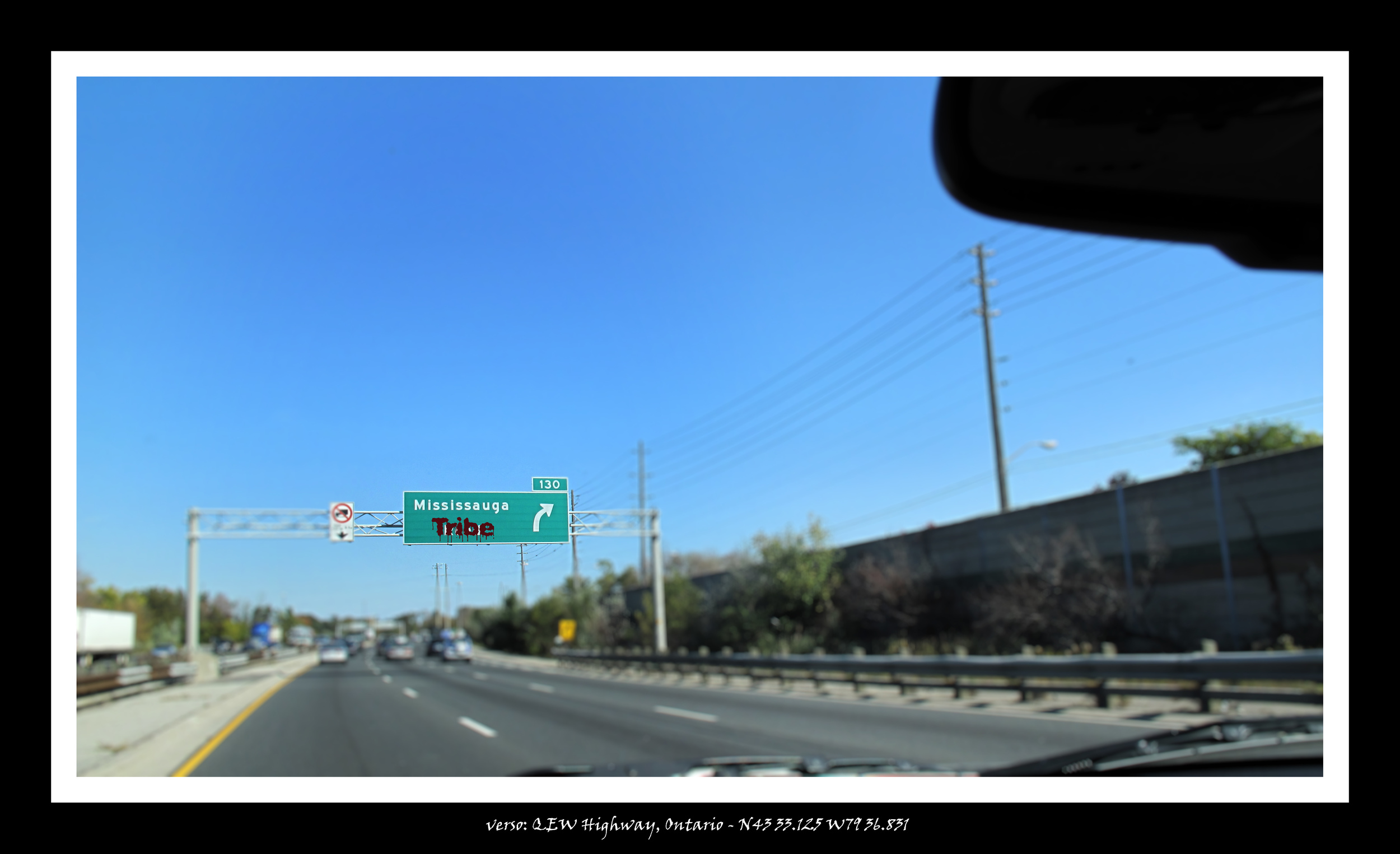 Graffito_Mississauga Exit sign from QEW.jpg