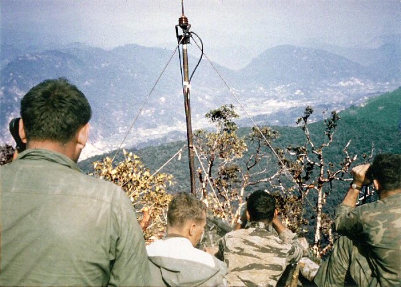 Lurps on Signal Hill directing artillery on enemy trucks in A Shau Valley (author in tiger fatigues)