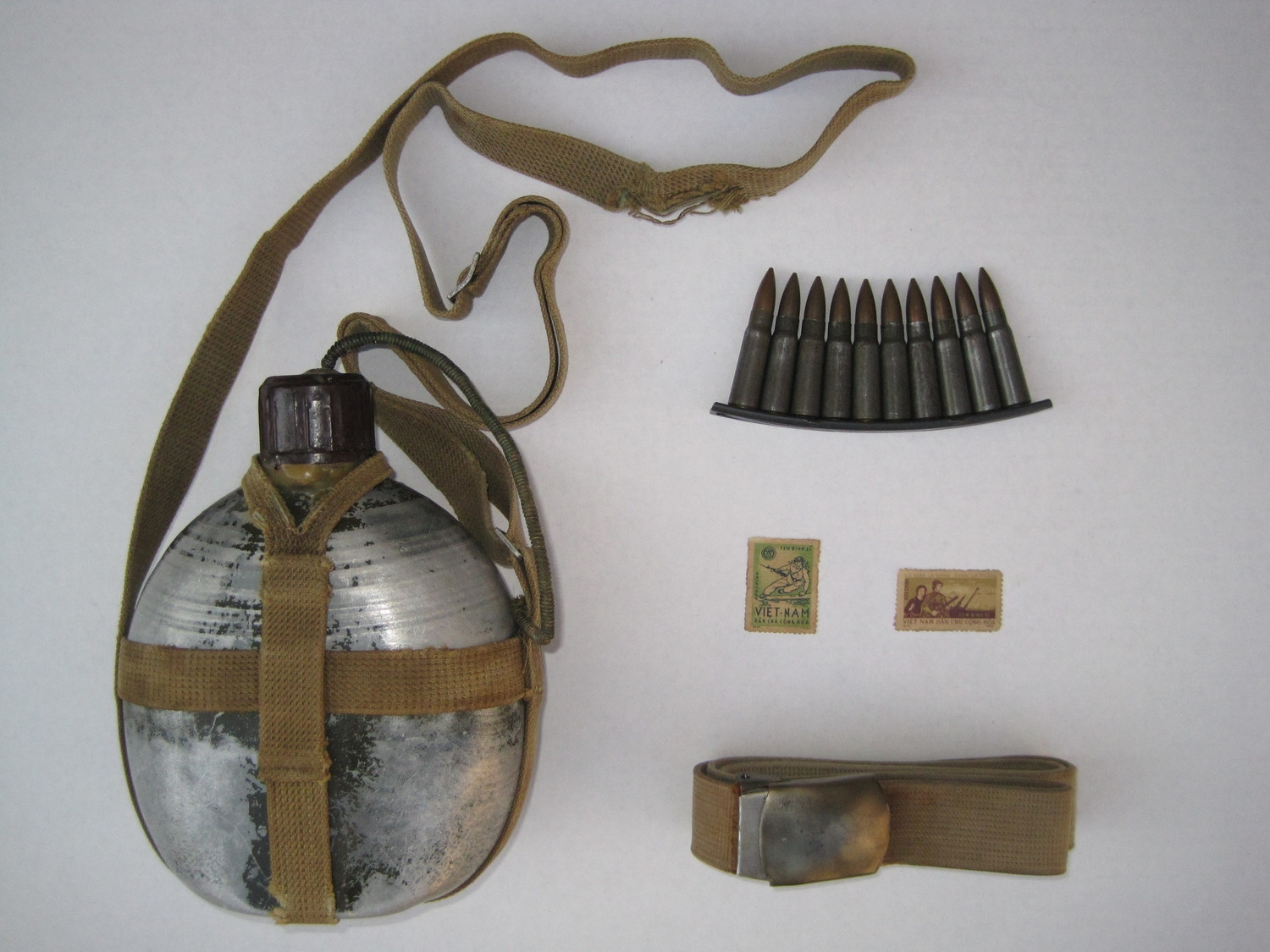 The sniper'scanteen,stripper clip, postage stamps, and belt