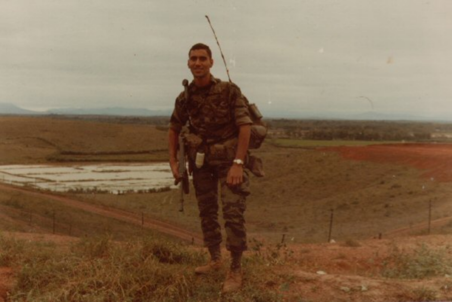Standing on the berm at LZ Betty with an M3A1