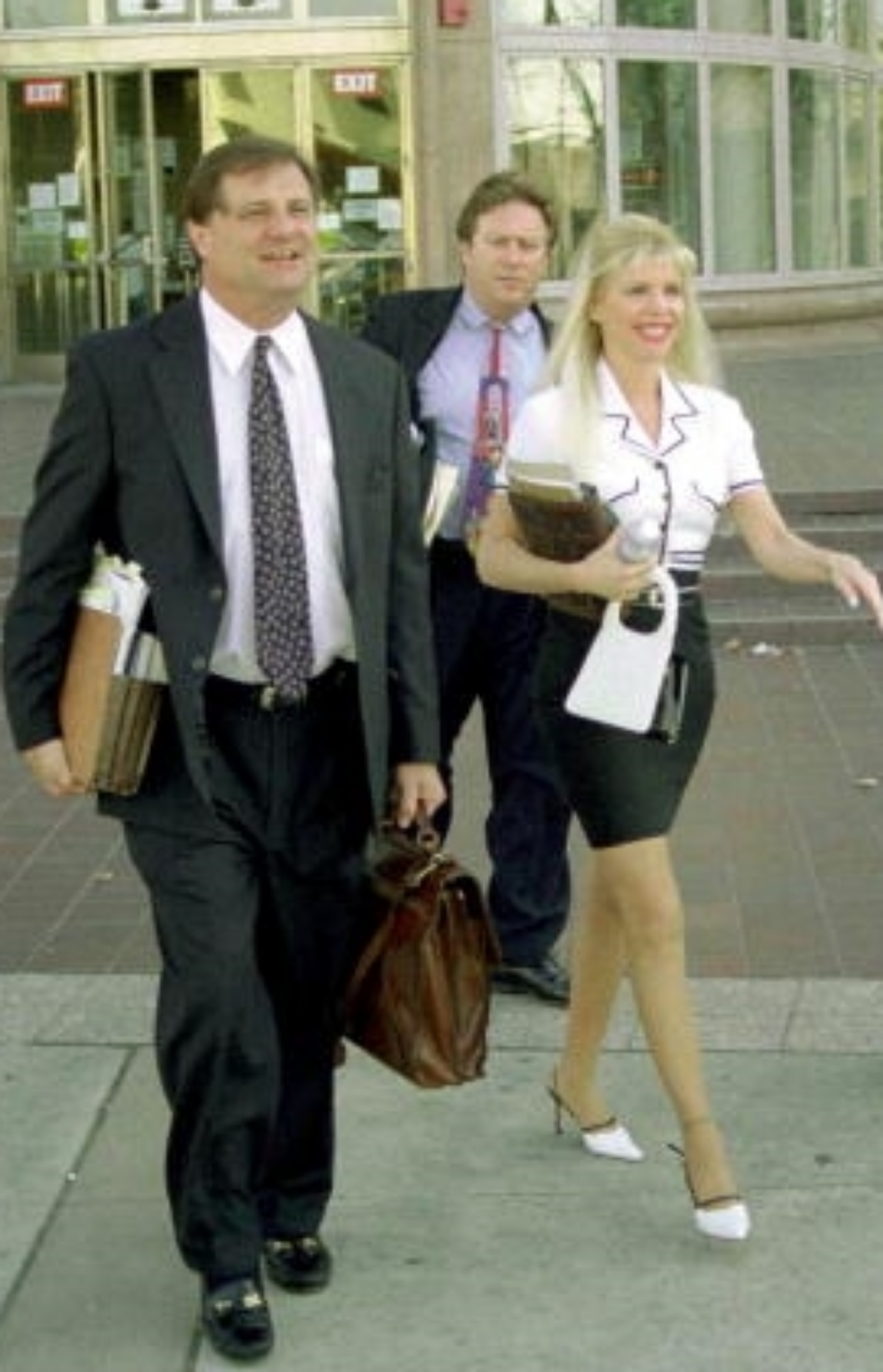 "Gerald Scotti (left); paralegal and ex-con, Barry ""Loophole"" Feldman; and Jody ""Babydol"" Gibson"