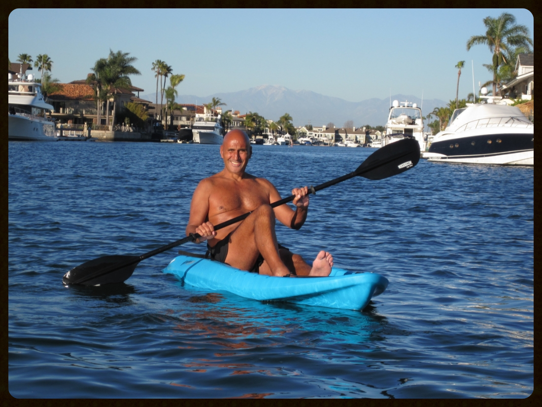 Monday, February 15, 2016. Kayaking in Huntington Harbour with my wife, Cathy. The air was 81 degrees and the water 59 degrees. I jumped off the kayak several times and enjoyed the combination of warm air and refreshing water. Behind me to the east are the Santa Ana Mountains. Snow capped Santiago Peak is 5,689 feet above sea level.