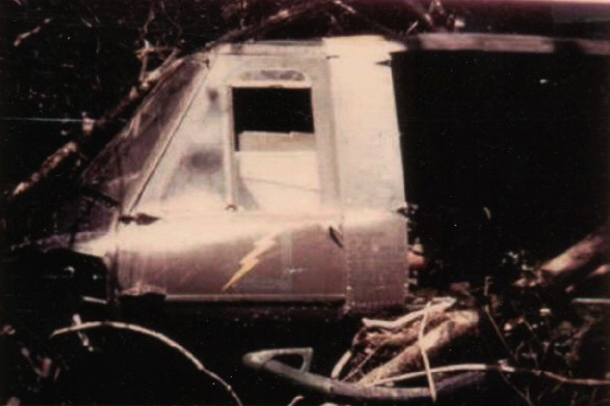 Signal Hill, crashed Huey, 227th Assault Helicopter Battalion. The trademark yellow lightning bolts insignia symbolizing the swiftness of their strikes, emblazoned on their sides
