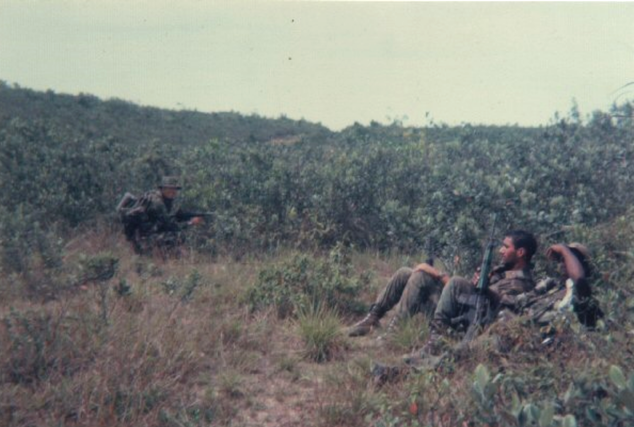 Cpl. Tony Griffith, in background (KIA near Cambodia, 2/5/69, just days before his twenty-first birthday)