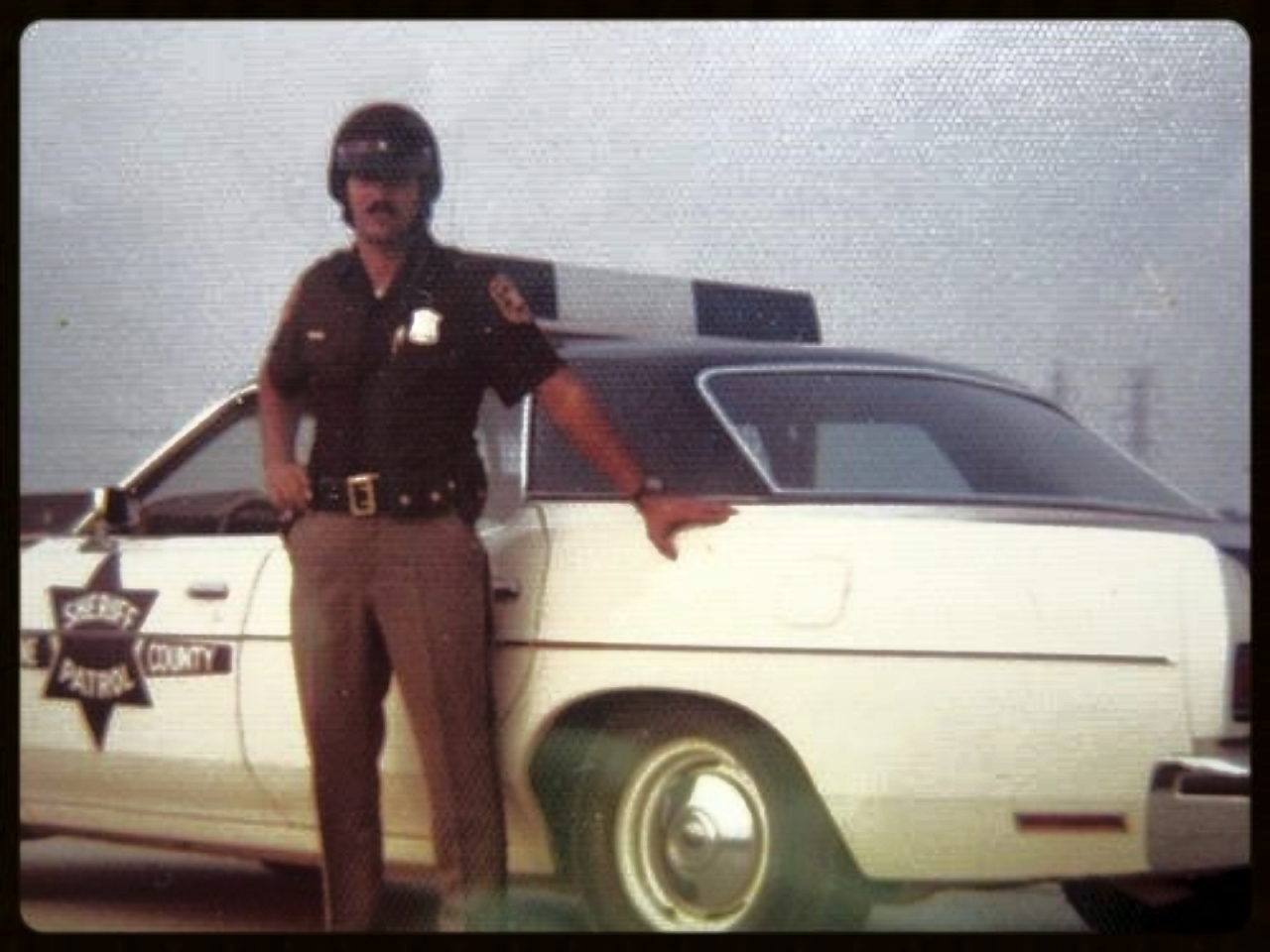 Thursday, July 19, 1973. Assigned to our Patrol and Investigation Division. I loved cruising the county. One Sunday morning as I drove a major highway I got into a chase with a woman and stopped her by shooting out her right tires with my .357 magnum. Her car was full of clothes and she was enraged at her husband so she took it out at me, biting and clawing until I dragged her out of the car as churchgoers stopped and gawked. Wives can be great companions and lots of fun, but from a cop's perspective,  an angry wife  can be something else all together. She can stop your heart. At a traffic accident one rainy night, placing flares in the road, another enraged housewife sped off without her glasses directly into the accident scene. I saw a pair of headlights bracketing me, one on the right and one on the left, barreling right at me. All I could do was leap straight up in the air. Her bumper caught me in both calves and I could hear her shrill screams as I reverse-somersaulted over her hood, windshield, roof, and trunk. I bounced off the pavement, saw a flash of light; then everything went black.