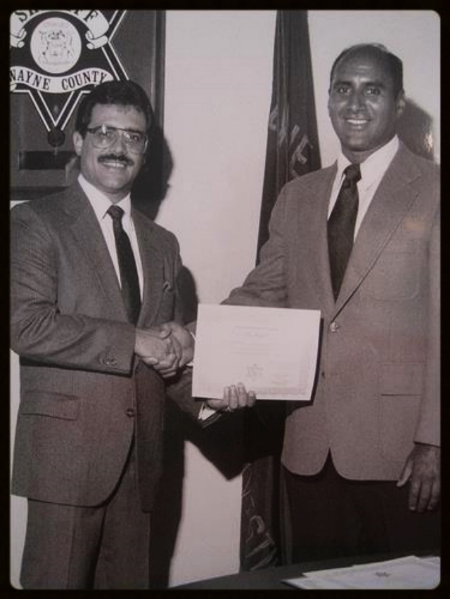 Friday, November 9, 1984. Sheriff Robert Ficano presenting me the Distinguished Service Award on my retirement.