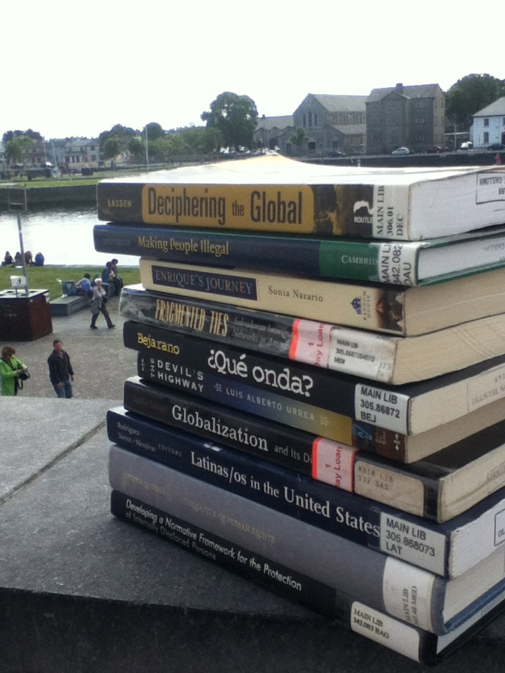 My stack of library resources for my thesis. Plus two books that I own and carried with me all the way from Oregon to Ireland. Pictured here on the balcony of my apartment in Galway, overlooking the Corrib river.