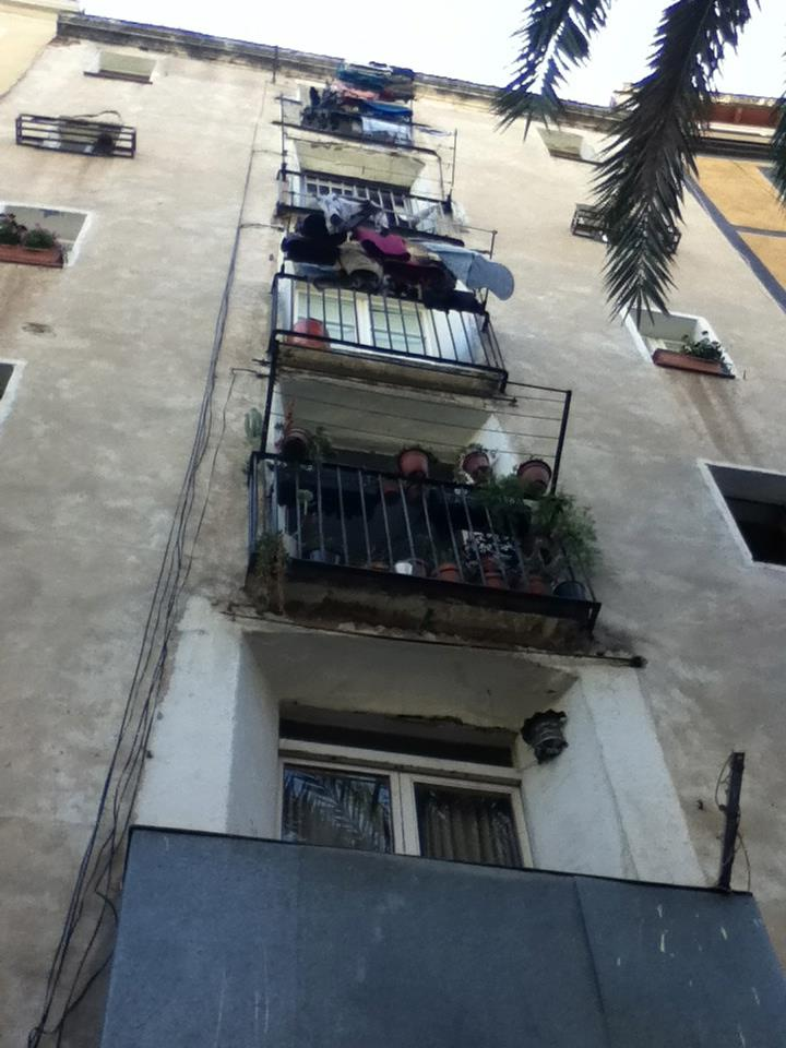 My laundry hanging out to dry from a balcony in Barcelona.