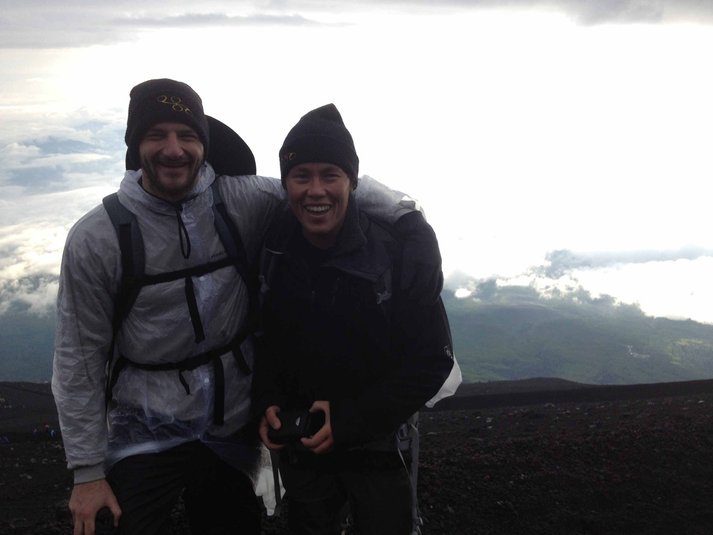 Miles and Aki on the summit of Mount Fuji