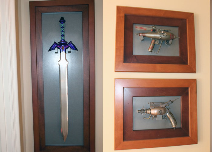 LEFT: We won a 2 of a kind Master Sword (made by Nintendo and used in a Zelda commercial) at a child charity event auction Nite2Unite.   RIGHT: Clifford's  Dr. Grordbort 's weapons he acquired at various Comic Cons.  (These are right outside the game room, in the hallway.)