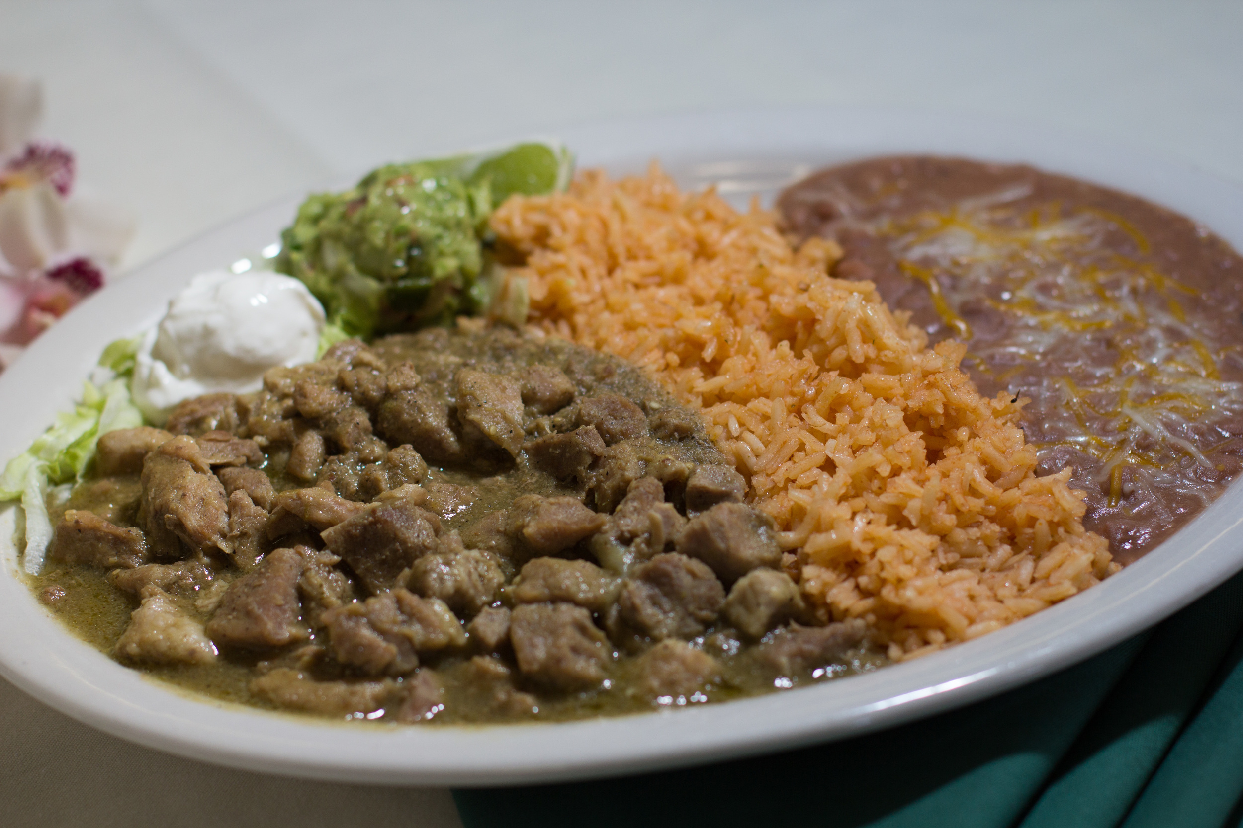 Chile Verde - Pork marinated in our special tomatillo sauce
