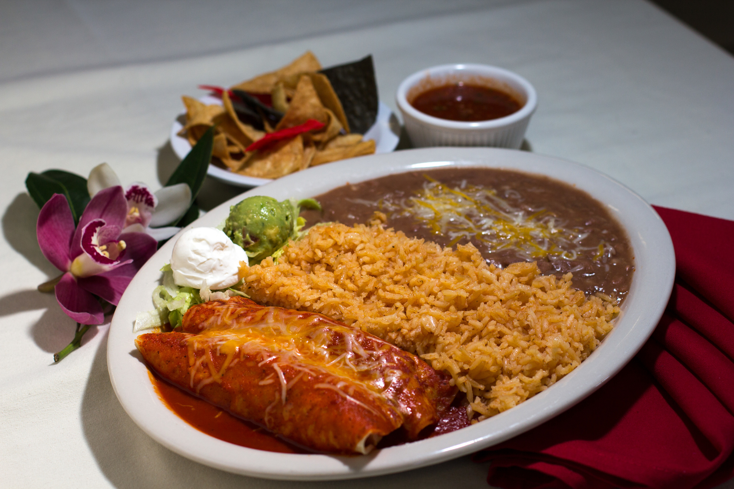 Enchiladas Mexicanas - Served in our red enchilada sauce