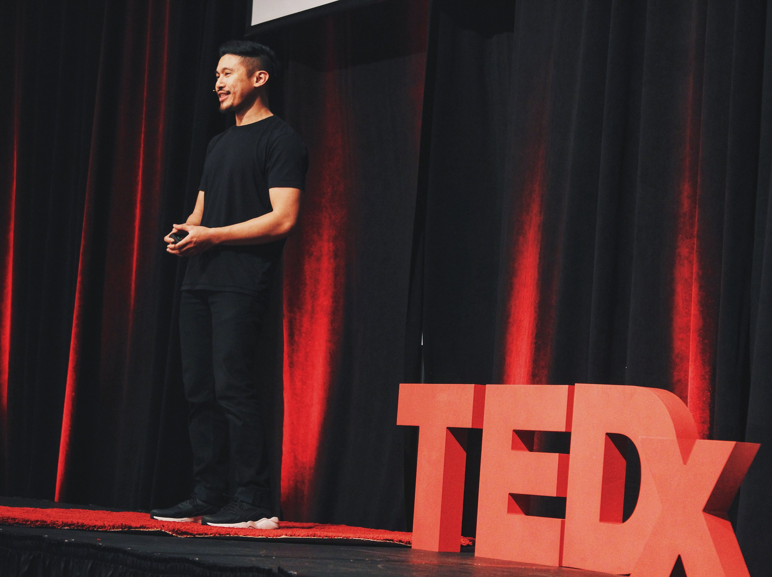2016 speaking on stage at TEDxCSULB.