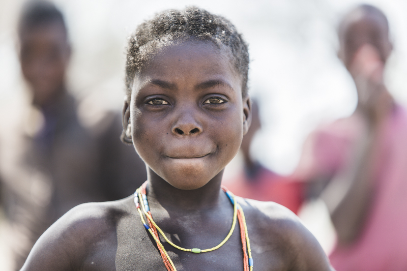I loved the determination on this little girl's face, as if standing in defiance of her 2 brothers behind her.  Cahama, Cunene Provence   ©24Atlantic