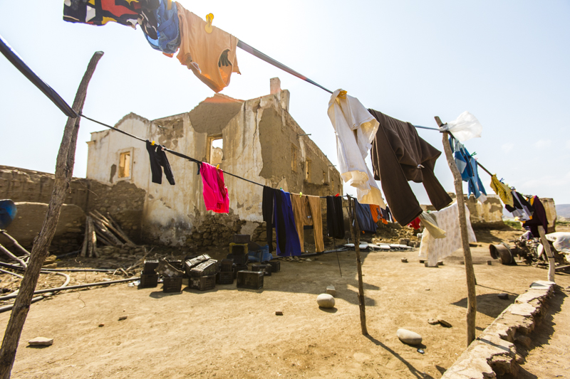 Colourful washing on the line in a small settlement dominated by an old fortress.  Carajumba, Namibe Provence  ©24Atlantic
