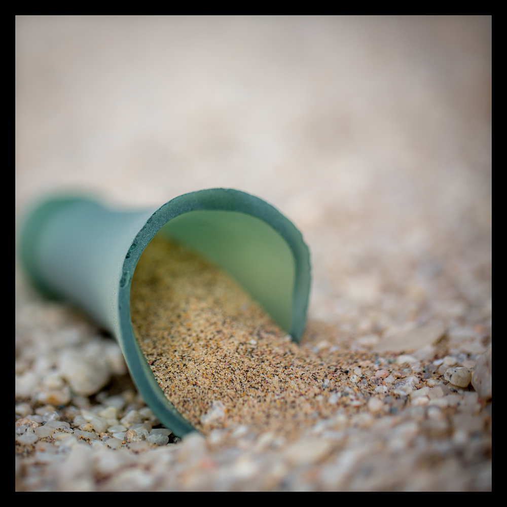 Broken bottle that is beautifully sand blasted.
