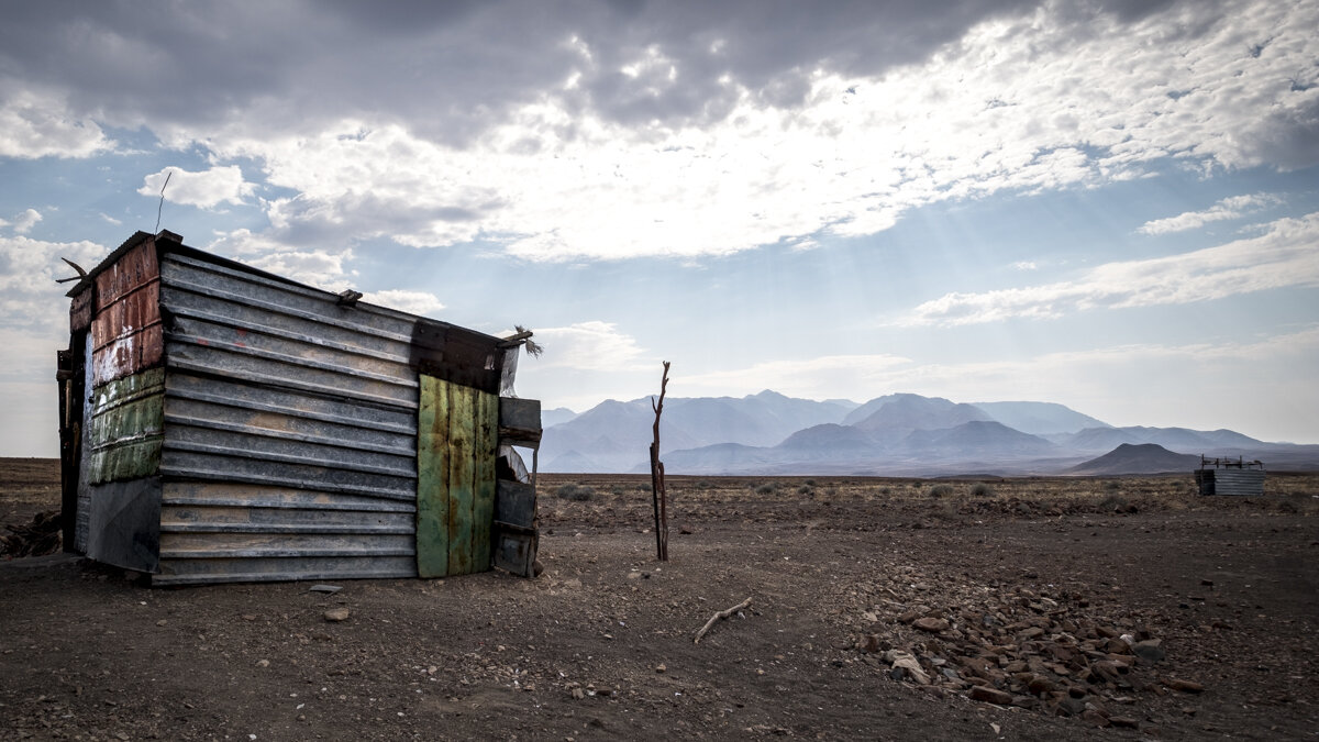 Home is a tin shack in the middle of stupendous scenery.