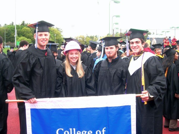 That's me on the far right with my buddies holding the banner before Commencement