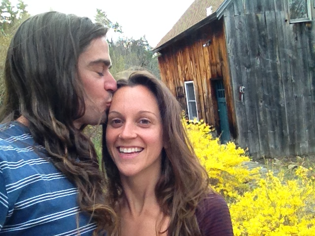 Derek Russell kisses wifes forehead at new art studio