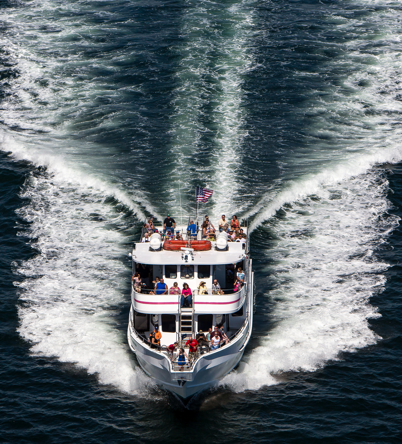 An aerial shot of a tour boat from Boothbay Harbor, Maine.