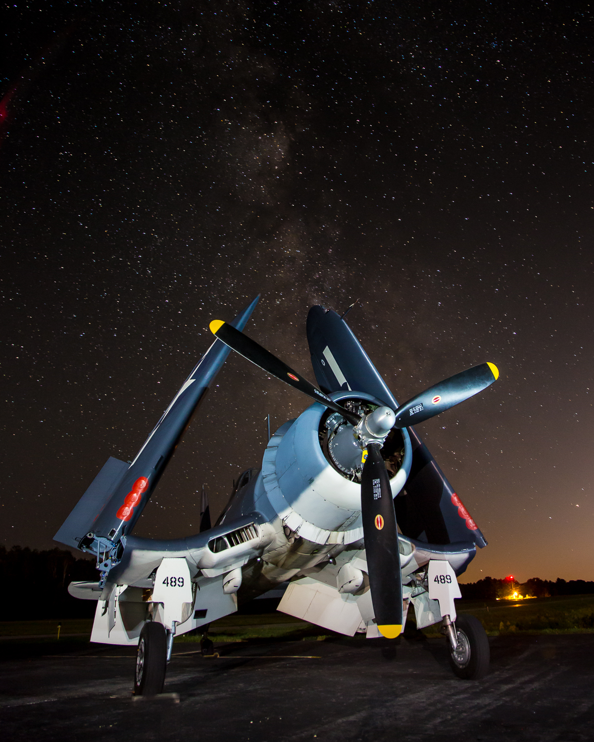 A WWII Corsair, light painted against the Milky Way.