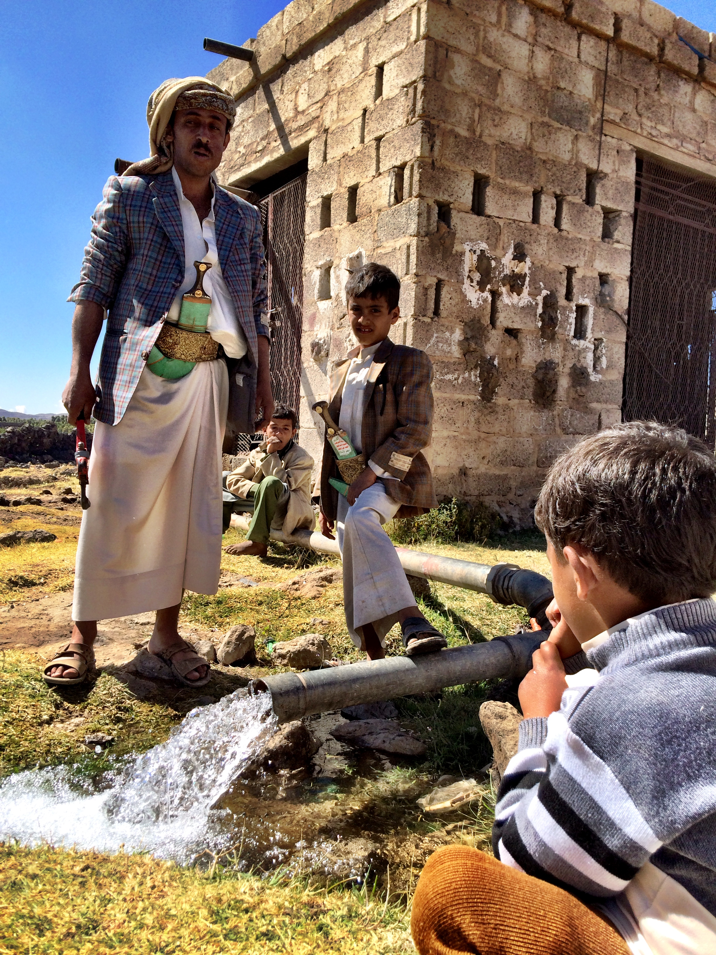 A Qat farmer in Hamdan watches as the water starts flowing. Photograph by Lucy Kafanov.