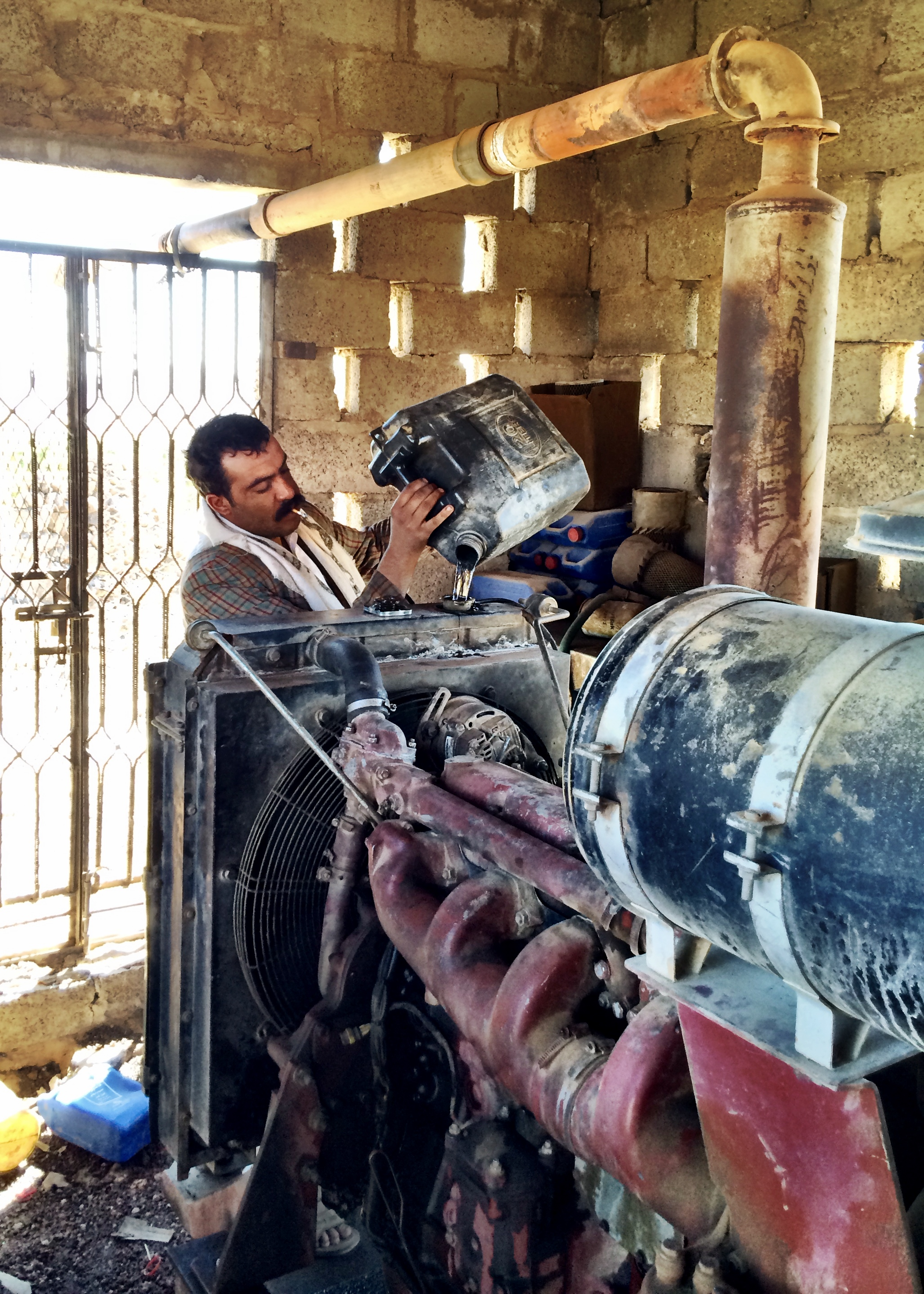 Subsidized diesel powers the well's water pumps. Photograph by Lucy Kafanov.