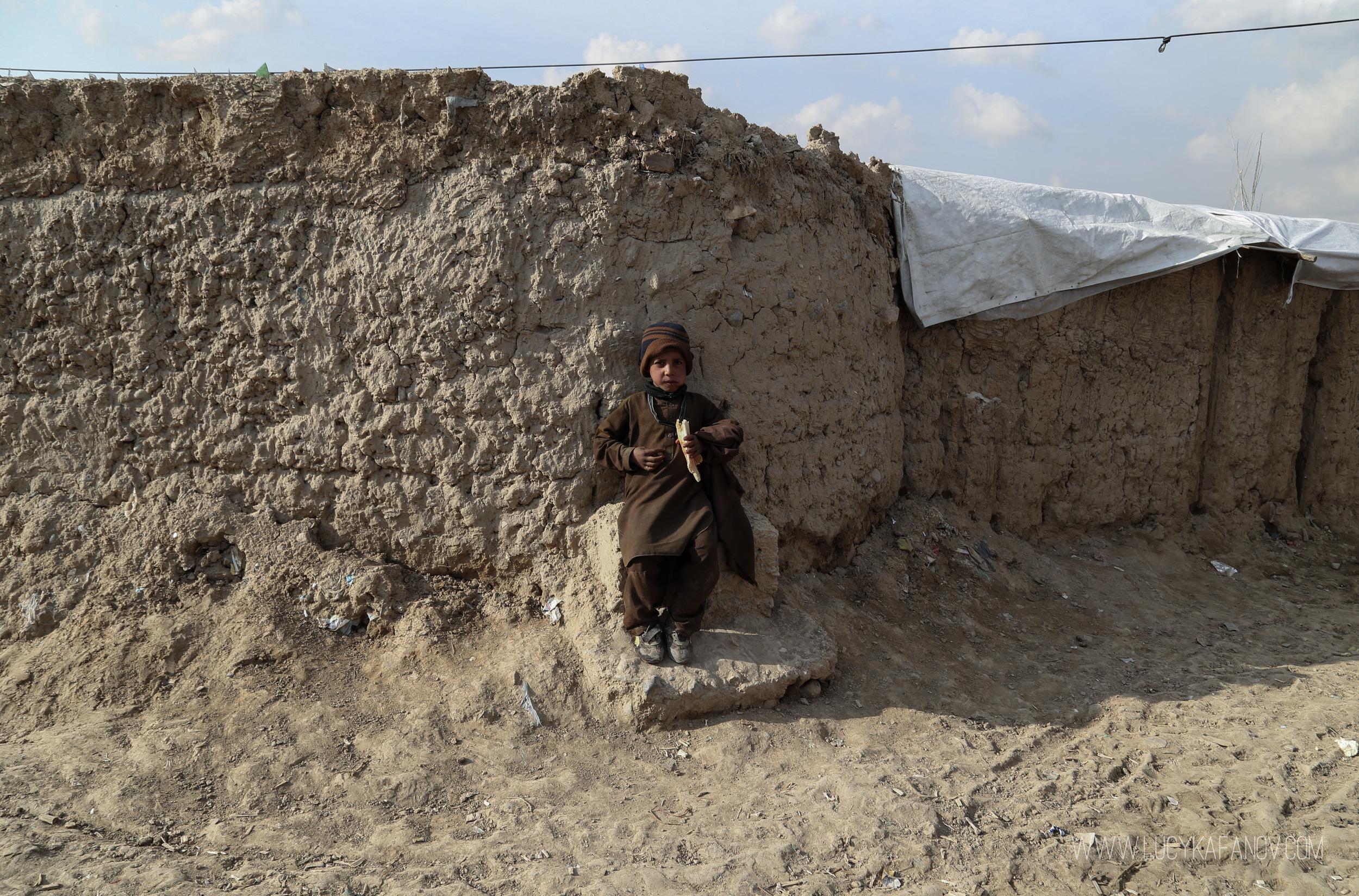 An Afghan boy, displaced by war.