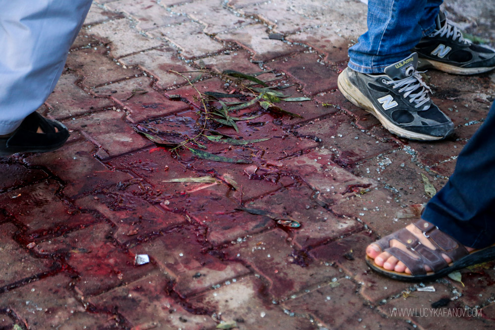 A pool of blood on the street where the suicide blast took place less than an hour before this photo was taken. Photograph by Lucy Kafanov.