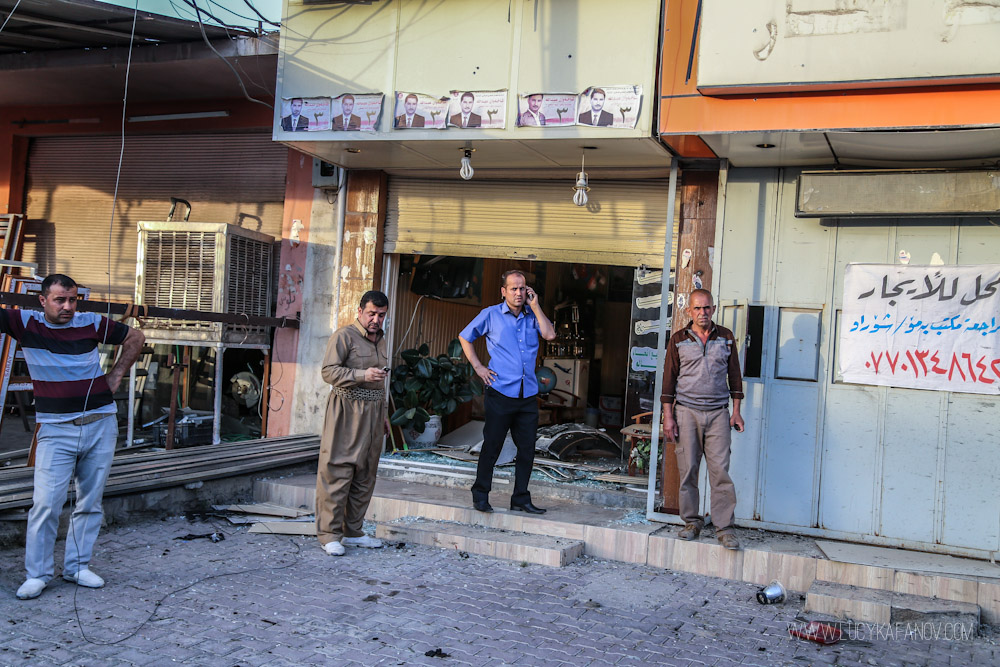 The impact of the blast shattered the glass storefronts of nearby businesses. Photograph by Lucy Kafanov.