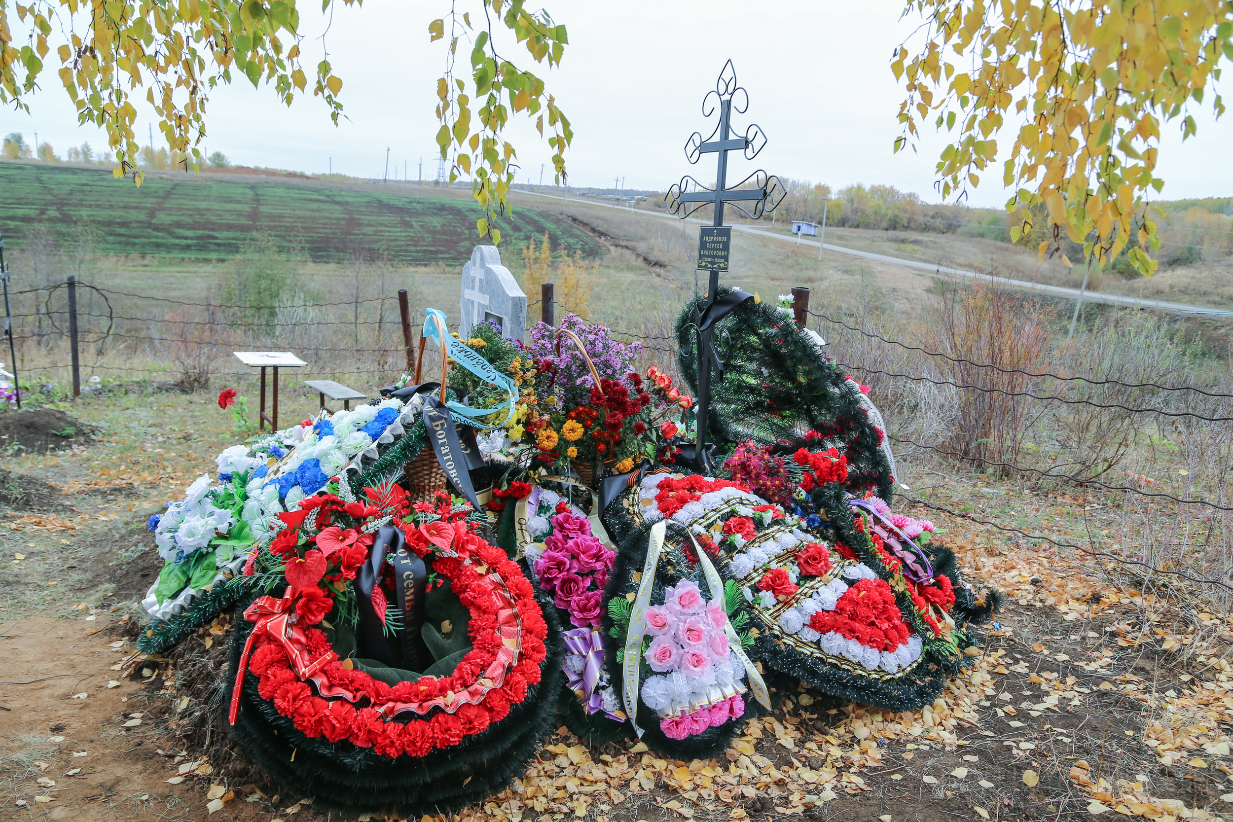 The grave of Sergei, a 20-year-old paratrooper believed to have been killed in action in Ukraine.
