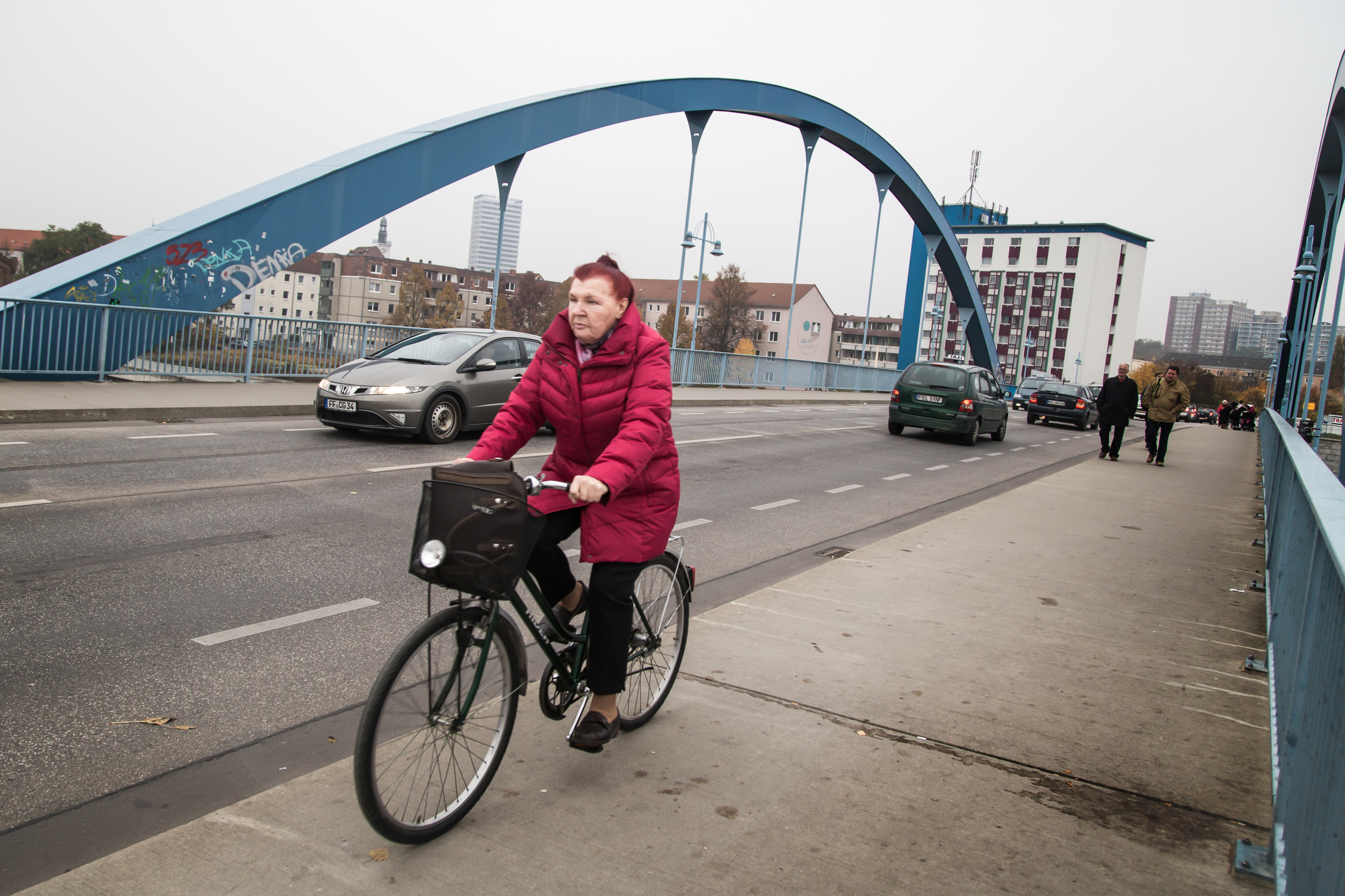 A woman bikes across the   Oder   bridge from Germany's Frankfurt into Slubice, where lower prices for goods draw German shoppers eager for a discount.