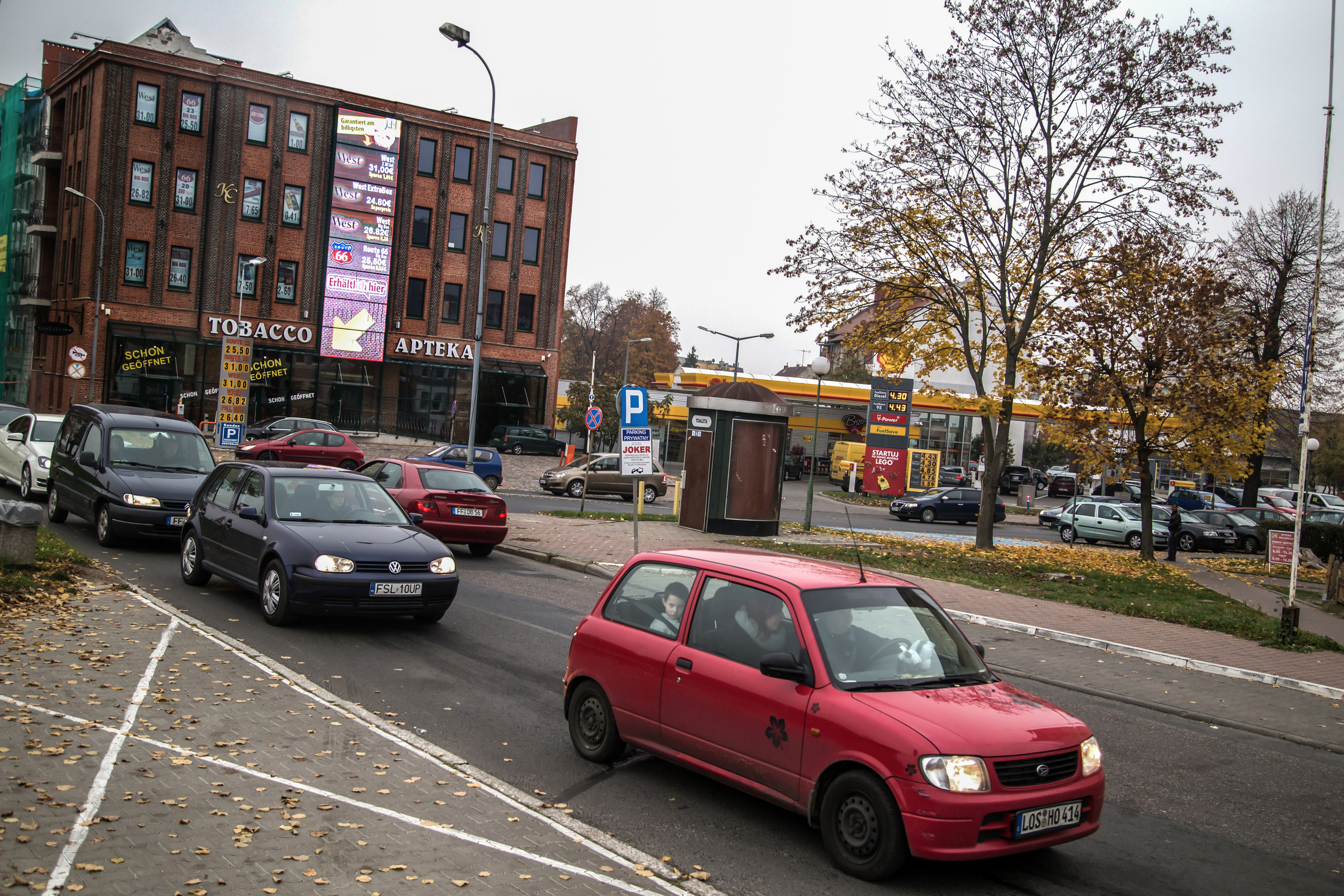 Cars with German and Polish license plates wait in Slubice traffic to cross the Oder bridge to Frankfurt. Many come to Poland to stock up on cheap cigarettes and discount fuel.